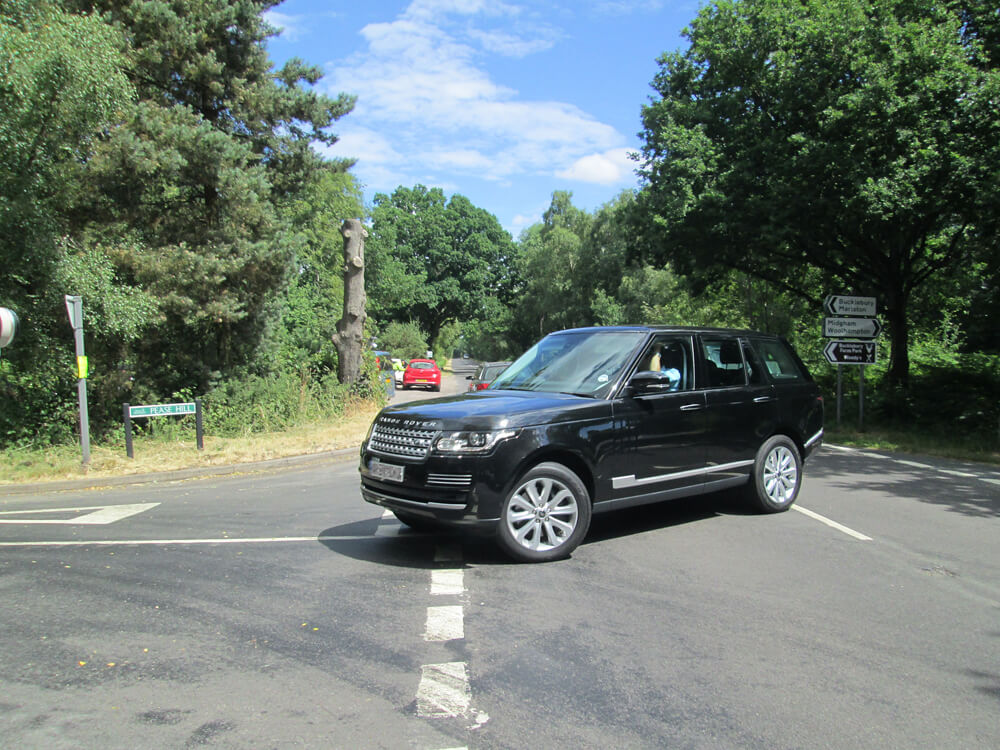 INS News Agency Ltd 24/07/2013 Prince William is pictured in the passenger seat of this Range Rover as he arrives home at Bucklebury this afternoon with the Duchess of Cambridge and their baby son in the back seat.