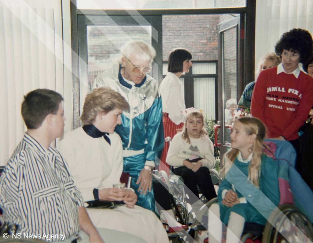 Princess Diana meets child patients at Stoke Mandeville hospital in 1983, when she opened the centre.  She is pictured with children in wheelchairs, Jimmy Saville and Janet Cope (on the right of picture). Allegations that Jimmy Savile sexually abused dozens of underage and vulnerable children over many years are being investigated by Scotland Yard.