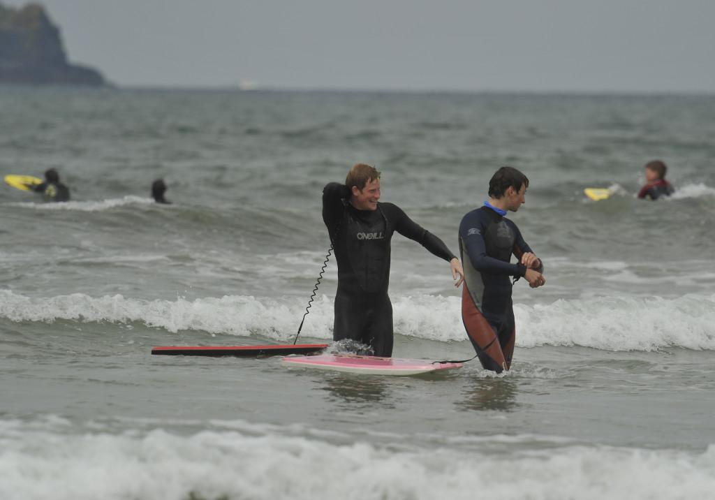 Prince Harry enjoying the surf at Polzeath Bay, Cornwall