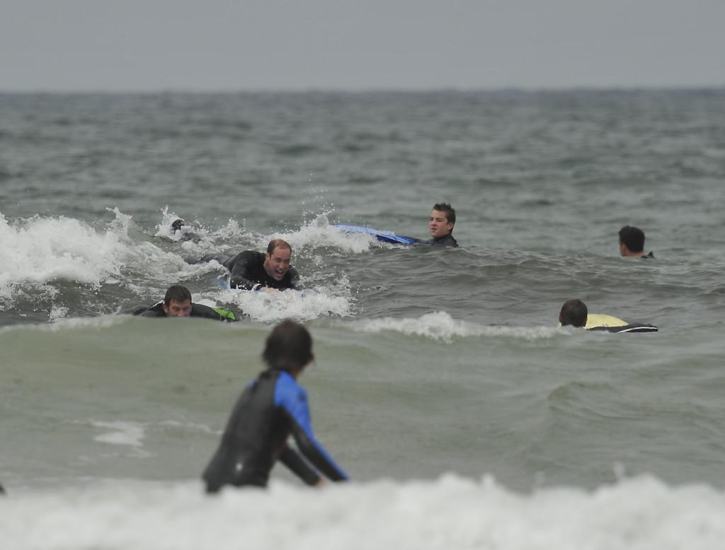Prince William enjoying the surf at Polzeath Bay, Cornwall