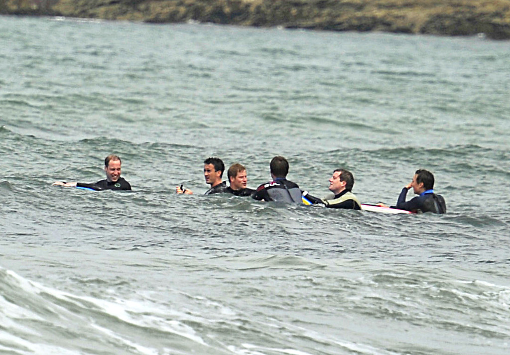 Princes William and Harry enjoying the surf at Polzeath Bay, Cornwall