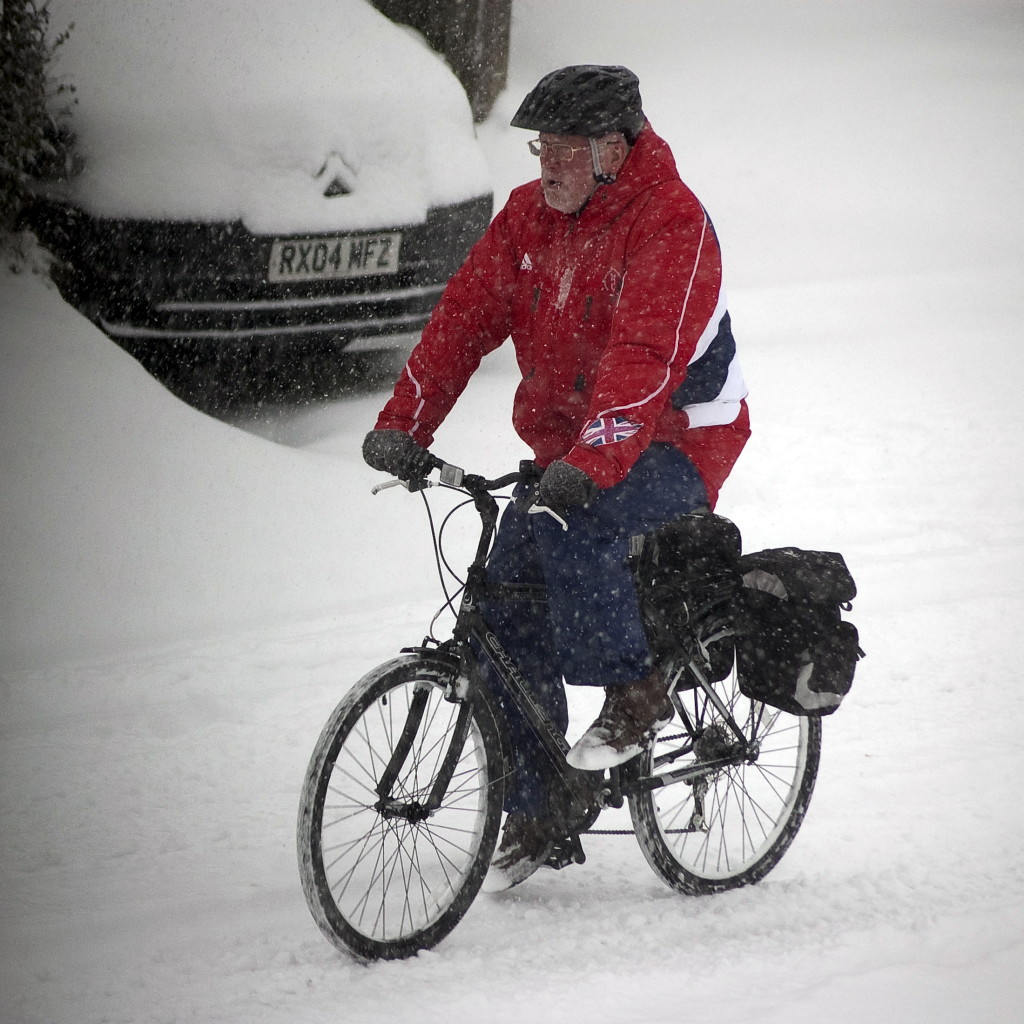 An elderly cyclist struggles through the snow today (Fri) in Burbage, Wilts., where more than four inches fell in a few hours. INS News Agency Ltd..18/01/2013
