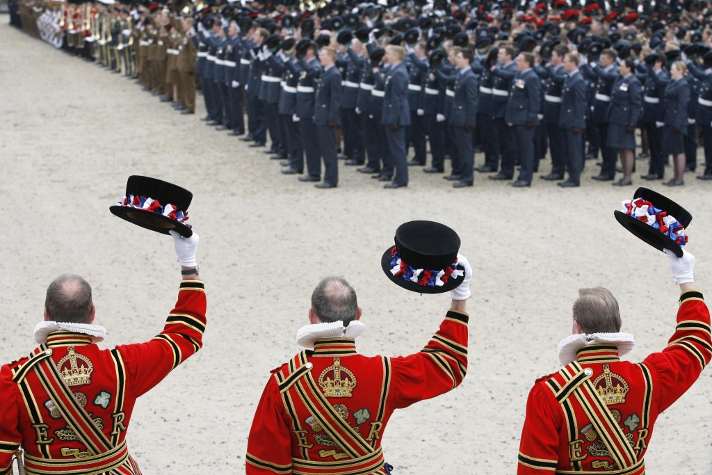 2500 servicemen and women from the three armed forces raise their hats and give three cheers to the Queen